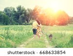 happy couple in love with dog... | Shutterstock . vector #668633854