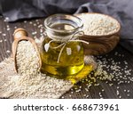 sesame oil in glass and seeds | Shutterstock . vector #668673961