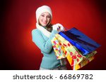 winter woman carrying colorful... | Shutterstock . vector #66869782