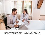 female doctor discussing with... | Shutterstock . vector #668702635