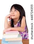 asian girl reading book | Shutterstock . vector #668724355