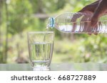 female hand pouring water from...   Shutterstock . vector #668727889