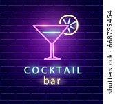 cocktail bar neon logo. bright... | Shutterstock .eps vector #668739454