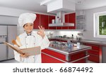 Cute young boy dressed in chef clothes, holding a book, doing the ok sign on a kitchen interior - stock photo