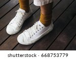 human leg wearing mustard socks ... | Shutterstock . vector #668753779
