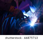 welder uses torch to make... | Shutterstock . vector #66875713