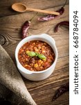 mexican chili con carne in bowl.... | Shutterstock . vector #668784094