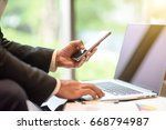 business man work with phone... | Shutterstock . vector #668794987