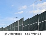 noise barrier on a highway | Shutterstock . vector #668798485