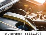 hand mechanic in repairing car...   Shutterstock . vector #668811979