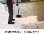 roofer worker painting  bitumen ... | Shutterstock . vector #668825944