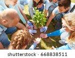 volunteering  charity  people... | Shutterstock . vector #668838511