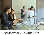 asian business people... | Shutterstock . vector #668853775