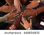 hands of happy group of african ... | Shutterstock . vector #668856835