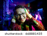a man at a party in a suit... | Shutterstock . vector #668881435