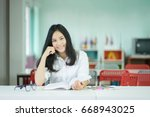 female student taking notes... | Shutterstock . vector #668943025