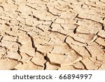 dry and cracked mud in dried up ... | Shutterstock . vector #66894997