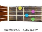 Small photo of ukulele chord Ab minor or Abm on white background, isolate