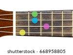 Small photo of ukulele chord Ab minor 7 or Abm 7 on white background, isolate