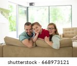 happy young family with little... | Shutterstock . vector #668973121