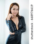 beauty woman in leather overalls | Shutterstock . vector #668976619