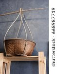 Small photo of hawker bamboo basket on a wooden shelf