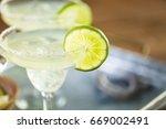 key lime margarita garnished... | Shutterstock . vector #669002491
