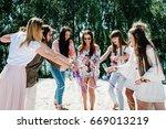 girl opens bottle of champagne. ... | Shutterstock . vector #669013219