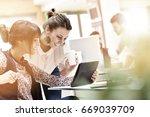 young women in office working... | Shutterstock . vector #669039709