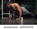 athlete doing push up as part... | Shutterstock . vector #669052459