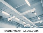 Small photo of Industrial Airflow in factory, Air duct, Danger and the cause of pneumonia in office man.