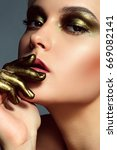 girl with gold make up and gold ... | Shutterstock . vector #669082141