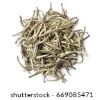 Small photo of White tea on white background. Top view. Close up. High resolution