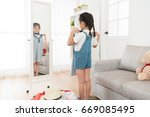 happy young little girl packing ...   Shutterstock . vector #669085495