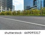empty asphalt road front of... | Shutterstock . vector #669095317