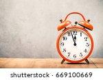 old retro orange alarm clock on ... | Shutterstock . vector #669100669