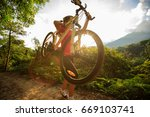 woman cyclist carrying mountain ... | Shutterstock . vector #669103741