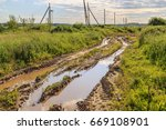 a country road with ruts and... | Shutterstock . vector #669108901