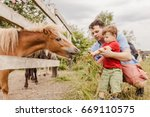 toddler boy and his father... | Shutterstock . vector #669110575