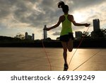 young fitness woman jumping... | Shutterstock . vector #669139249