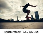 young woman skateboarder... | Shutterstock . vector #669139255
