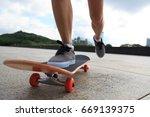 young woman skateboarder legs... | Shutterstock . vector #669139375