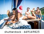 fiends having fun on a sail boat | Shutterstock . vector #669169825