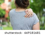 woman with pain in shoulder.... | Shutterstock . vector #669181681