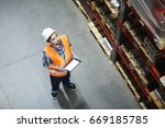 dispatcher in helmet and... | Shutterstock . vector #669185785