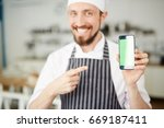 happy chef pointing at... | Shutterstock . vector #669187411