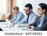 businesspeople sitting in row... | Shutterstock . vector #669190321