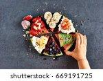 little kid eating sliced  juicy ... | Shutterstock . vector #669191725