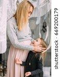 beautiful mother hugging her... | Shutterstock . vector #669200179
