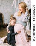 beautiful mother hugging her... | Shutterstock . vector #669200209